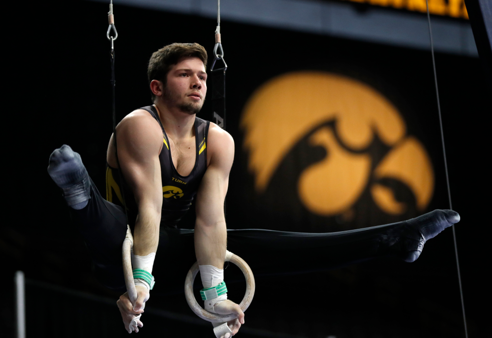 Rogelio Vazquez competes on the rings against Minnesota and Air Force