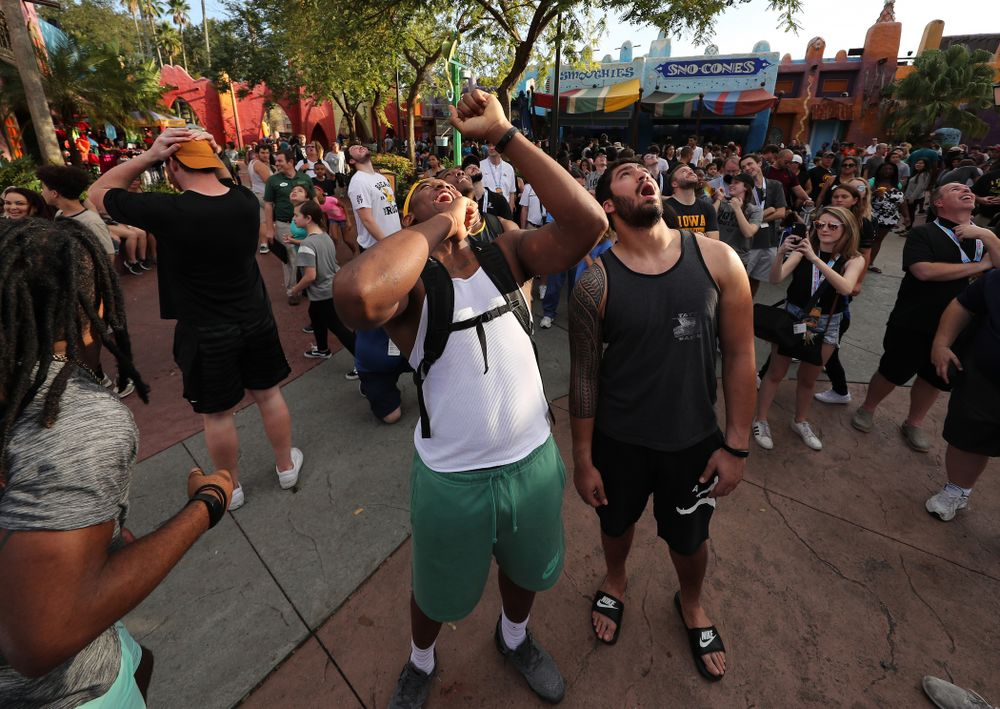 Iowa Hawkeyes defensive end Chauncey Golston (57) and defensive end A.J. Epenesa (94) react as they watch the Falcon's Fury ride during an Outback Bowl team event Saturday, December 29, 2018 at Busch Gardens in Tampa, FL. (Brian Ray/hawkeyesports.com)