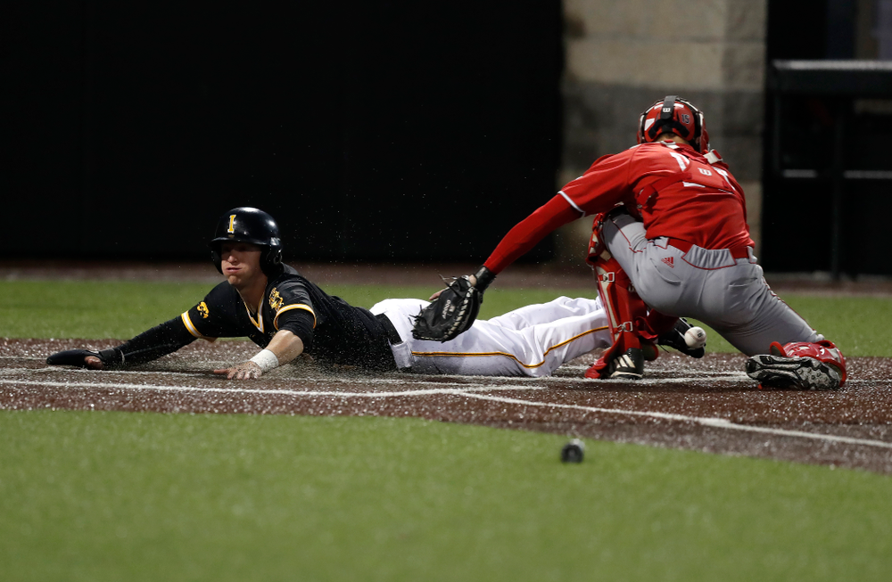 Iowa Hawkeyes catcher Tyler Cropley (5) scores against the Bradley Braves Wednesday, March 28, 2018 at Duane Banks Field. (Brian Ray/hawkeyesports.com)