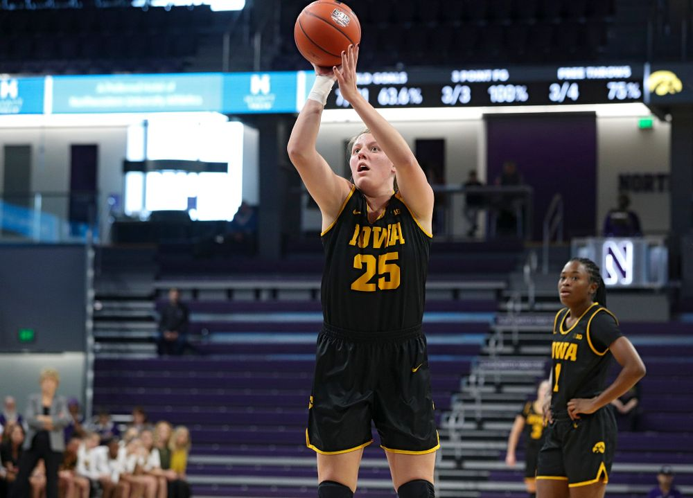 Iowa Hawkeyes forward Monika Czinano (25) makes a free throw during the first quarter of their game at Welsh-Ryan Arena in Evanston, Ill. on Sunday, January 5, 2020. (Stephen Mally/hawkeyesports.com)
