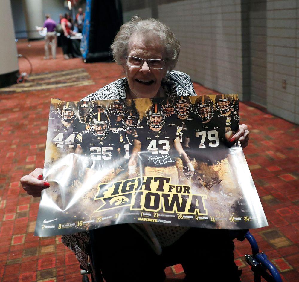 Martha Duke, widow of Wayne Duke, cherishes a poster signed by Kirk Ferentz.