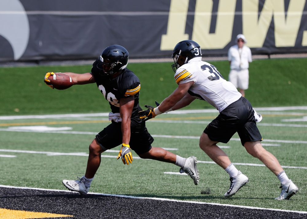 Iowa Hawkeyes running back Toren Young (28) and defensive back Jake Gervase (30) during practice No. 7 of fall camp Friday, August 10, 2018 at the Kenyon Football Practice Facility. (Brian Ray/hawkeyesports.com)