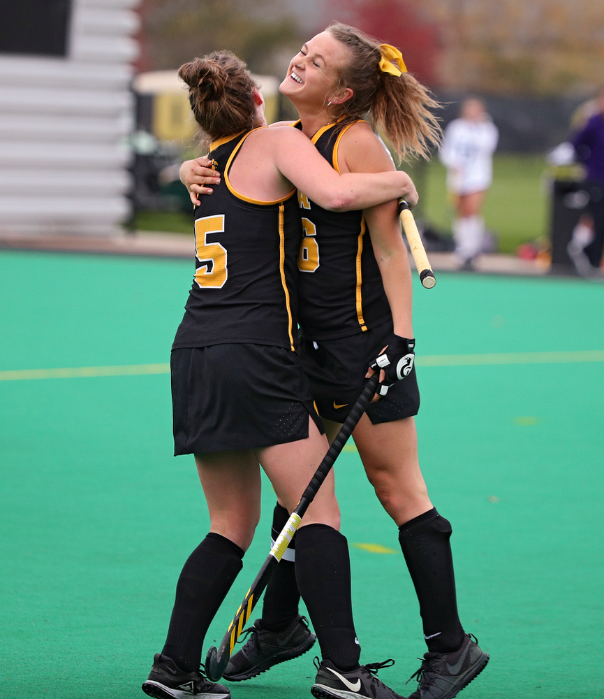 Iowa's Meghan Conroy (5) celebrates with Maddy Murphy (26) after Murphy scored a goal during the fourth quarter of their game at Grant Field in Iowa City on Saturday, Oct 26, 2019. (Stephen Mally/hawkeyesports.com)