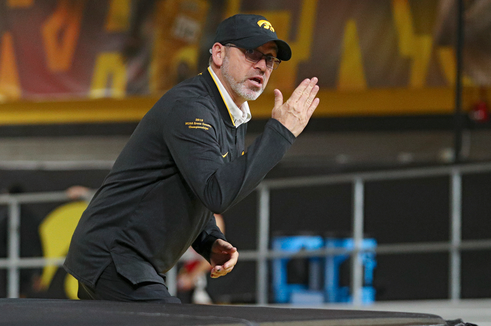 Iowa associate head coach Randy Hasenbank urges on his team during the women's 3000 meter run event during the Hawkeye Invitational at the Recreation Building in Iowa City on Saturday, January 11, 2020. (Stephen Mally/hawkeyesports.com)