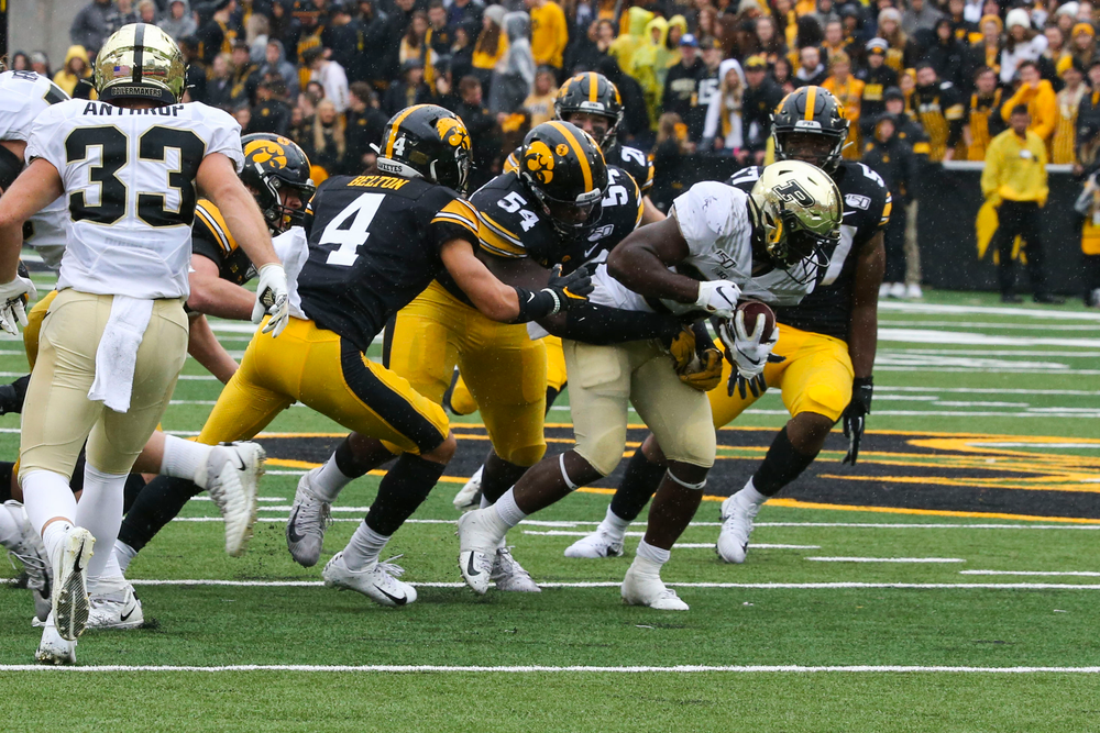 Iowa Hawkeyes defensive back Dane Belton (4) and Iowa Hawkeyes defensive tackle Daviyon Nixon (54) during Iowa football vs Purdue on Saturday, October 19, 2019 at Kinnick Stadium. (Lily Smith/hawkeyesports.com)