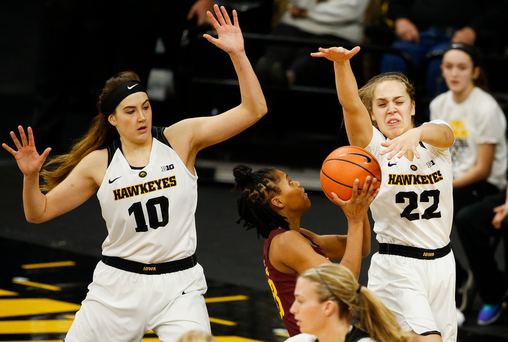 Iowa Hawkeyes forward Megan Gustafson (10), Iowa Hawkeyes guard Kathleen Doyle (22)
