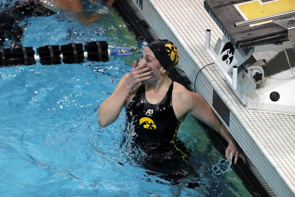 Iowa's Abby Schneider reacts to her time the 1000-yard freestyle against the Iowa State Cyclones in the Iowa Corn Cy-Hawk Series Friday, December 7, 2018 at at the Campus Recreation and Wellness Center. (Brian Ray/hawkeyesports.com)