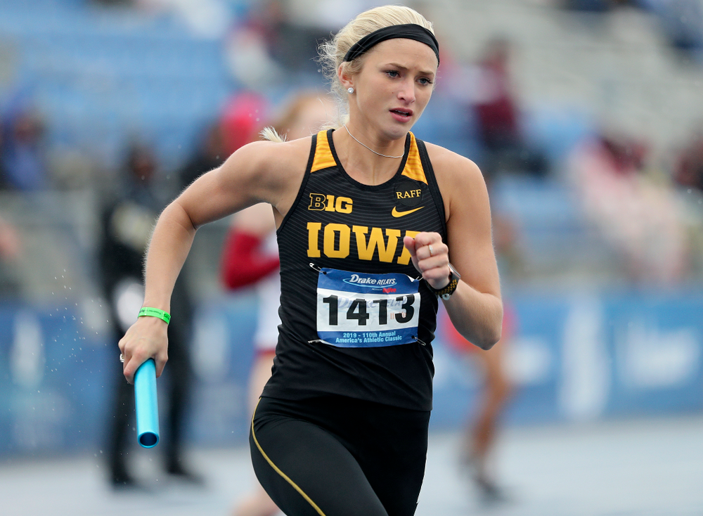 Iowa's Aly Weum runs the women's 1600 meter relay event during the third day of the Drake Relays at Drake Stadium in Des Moines on Saturday, Apr. 27, 2019. (Stephen Mally/hawkeyesports.com)
