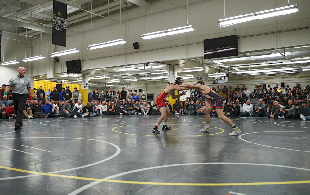 Iowa's Carter Happel (from left) and Justin Stickley during their preseason match at the Dan Gable Wrestling Complex at Carver-Hawkeye Arena in Iowa City on Thursday, Nov 7, 2019. (Stephen Mally/hawkeyesports.com)