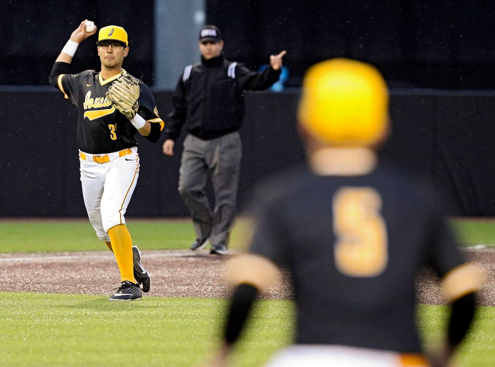 Iowa Hawkeyes third baseman Matthew Sosa (31) throw to first baseman Zeb Adreon (5) for an out during the ninth inning of their game against Illinois State at Duane Banks Field in Iowa City on Wednesday, Apr. 3, 2019. (Stephen Mally/hawkeyesports.com)