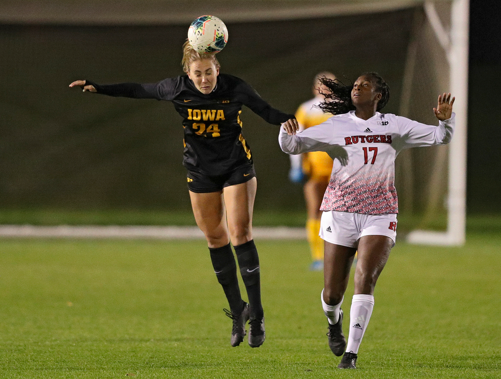 Iowa defender Sara Wheaton (24) gets up for a header during the first half of their match at the Iowa Soccer Complex in Iowa City on Friday, Oct 11, 2019. (Stephen Mally/hawkeyesports.com)