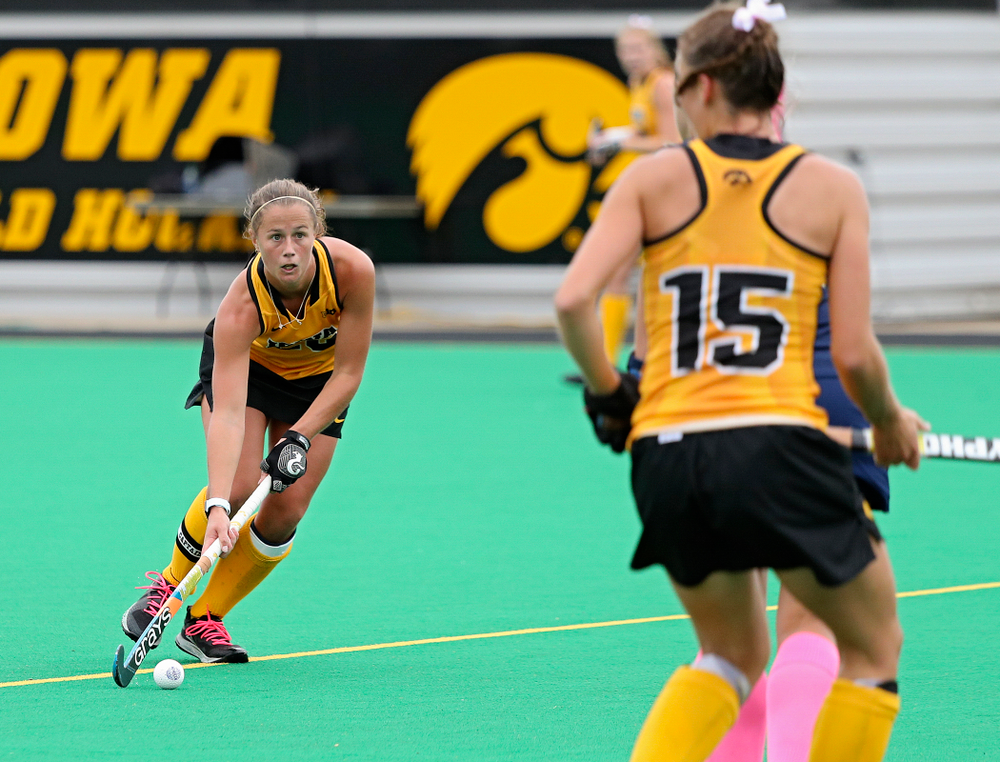 Iowa's Sophie Sunderland (20) keeps her eyes up as she moves with the ball during the second quarter of their game against UC Davis at Grant Field in Iowa City on Sunday, Oct 6, 2019. (Stephen Mally/hawkeyesports.com)