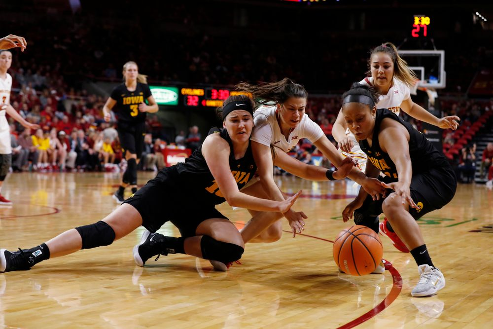 Iowa Hawkeyes forward Megan Gustafson (10) and guard Tania Davis (11)