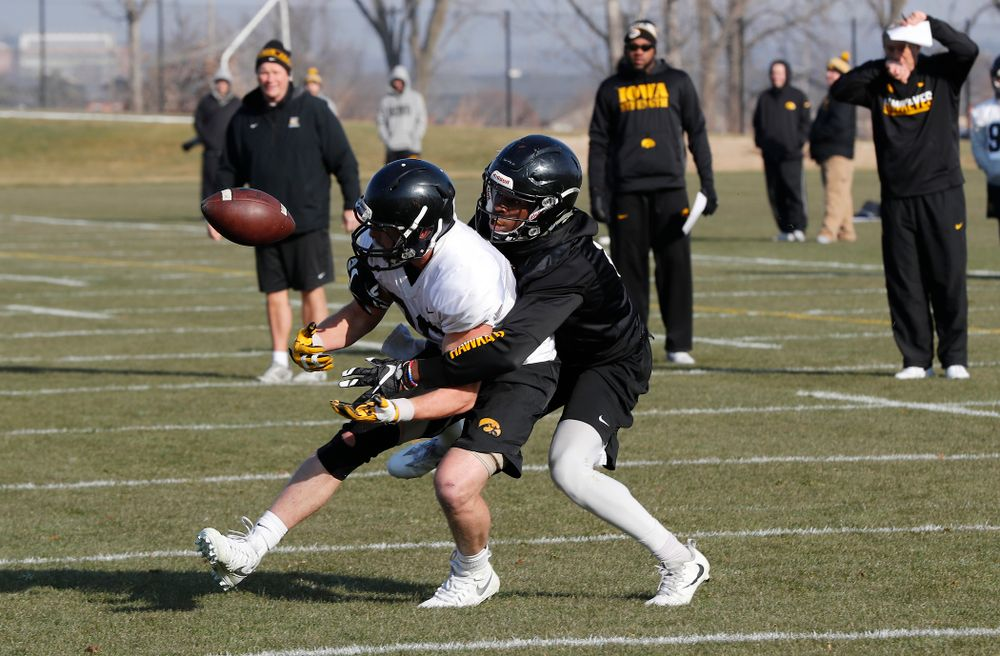 Iowa Hawkeyes wide receiver Matt VandeBerg (89) and Iowa Hawkeyes defensive back Matt Hankins (8)
