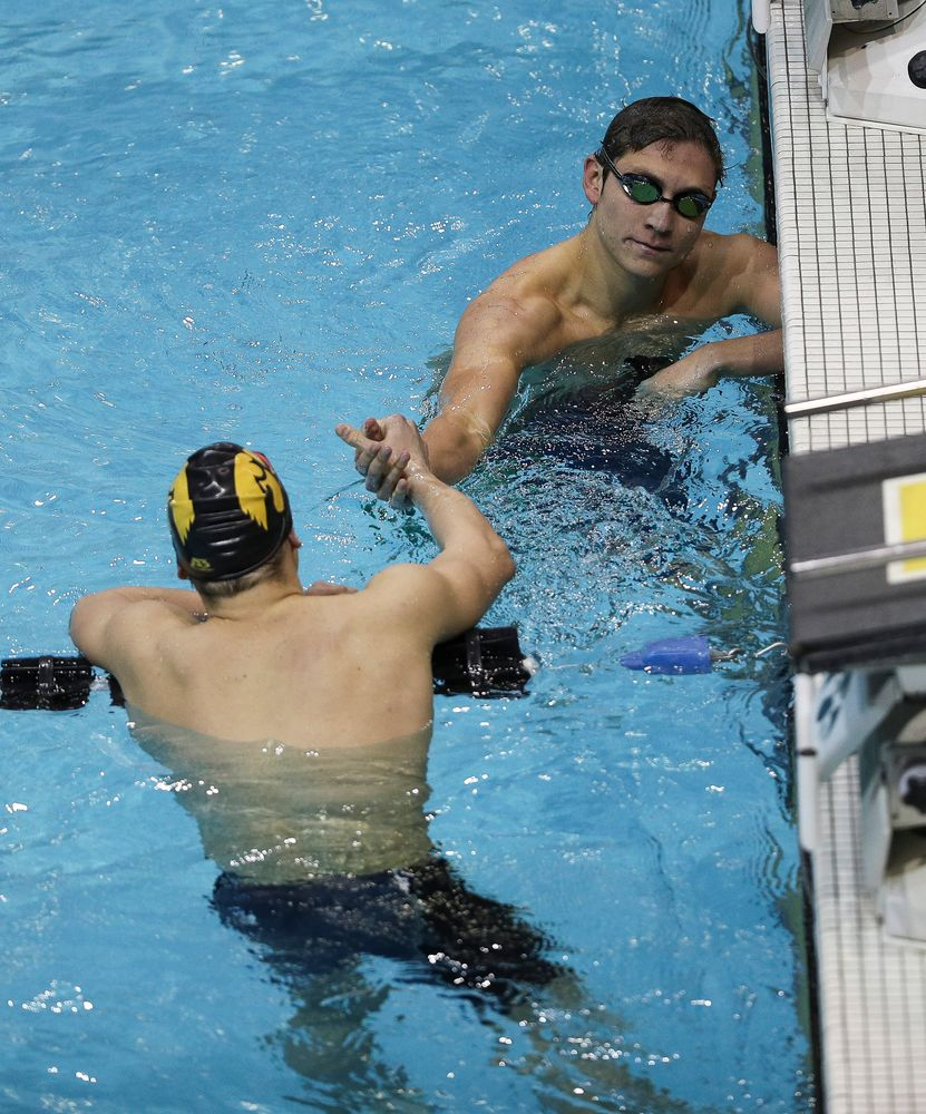 Iowa's Michael Tenney congratulates teammate Anze Fers Erzen after finishing the 400-yard IM during the third day of the Hawkeye Invitational at the Campus Recreation and Wellness Center on November 16, 2018. (Tork Mason/hawkeyesports.com)