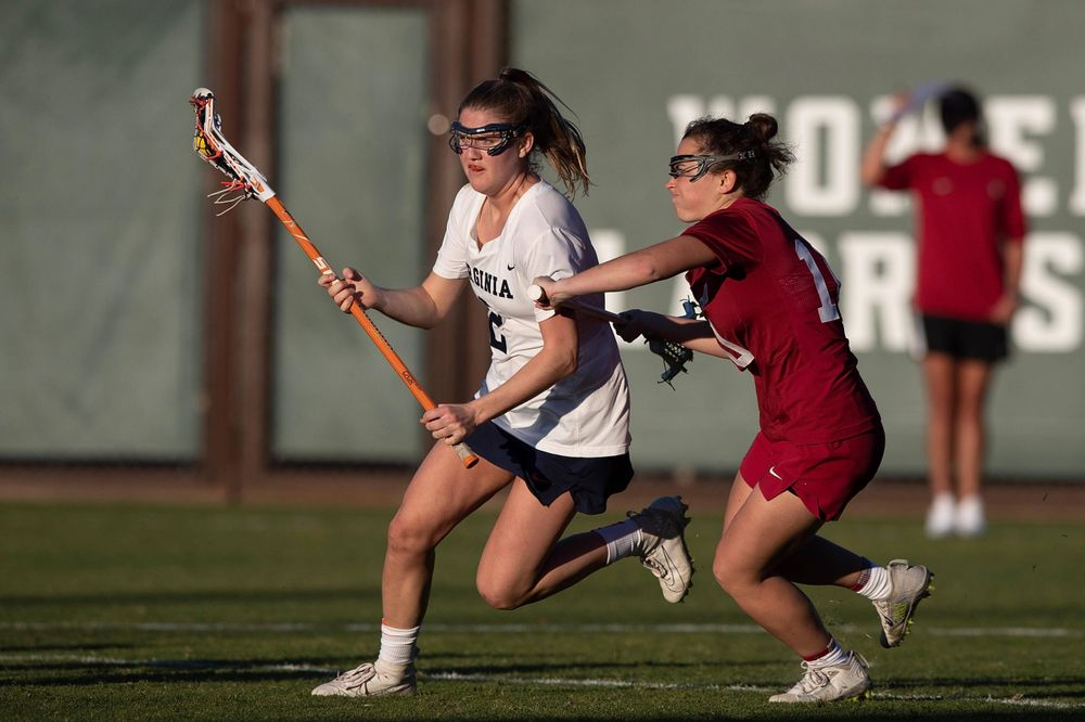 STANFORD, California - FEBRUARY 14:  Virginia Cavaliers midfield Sammy Mueller (2) is defended by Stanford Cardinal midfield Caitlin Chicoski (10) during the second half at Cagan Stadium on February 14, 2020 in Stanford, California. The Virginia Cavaliers defeated the Stanford Cardinal 12-11. (Photo by Jason O. Watson)