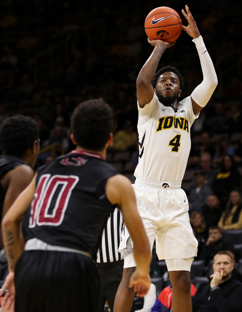 Iowa Hawkeyes guard Isaiah Moss (4) puts up a 3-pointer during a game against Guilford College at Carver-Hawkeye Arena on November 4, 2018. (Tork Mason/hawkeyesports.com)
