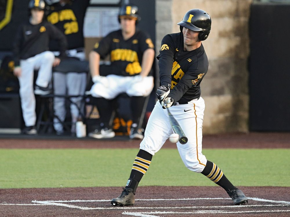 Iowa outfielder Justin Jenkins (6) bats during the fifth inning of their college baseball game at Duane Banks Field in Iowa City on Tuesday, March 10, 2020. (Stephen Mally/hawkeyesports.com)