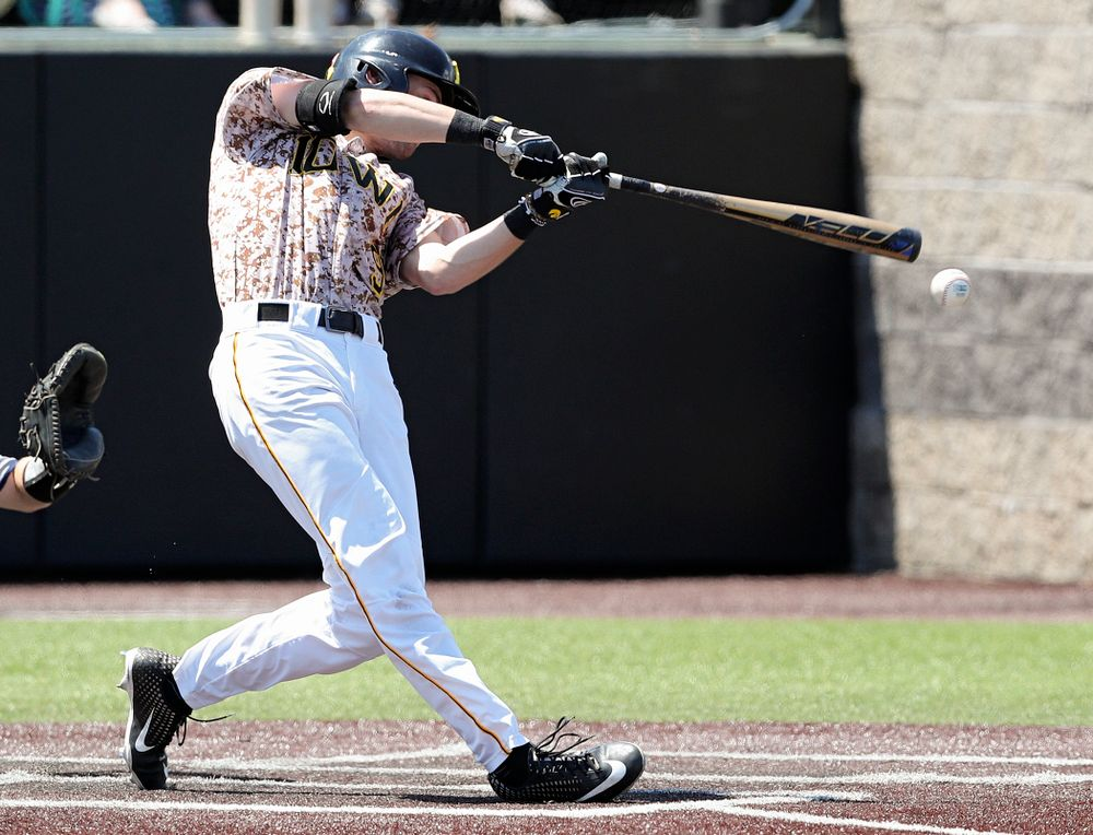 Iowa Hawkeyes center fielder Ben Norman (9) hits an RBI double during the first inning of their game against UC Irvine at Duane Banks Field in Iowa City on Sunday, May. 5, 2019. (Stephen Mally/hawkeyesports.com)