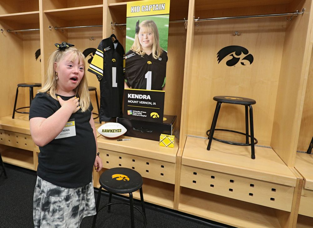 Kid Captain Kendra Hines reacts after seeing her locker in the Iowa locker room during Kids Day at Kinnick Stadium in Iowa City on Saturday, Aug 10, 2019. (Stephen Mally/hawkeyesports.com)