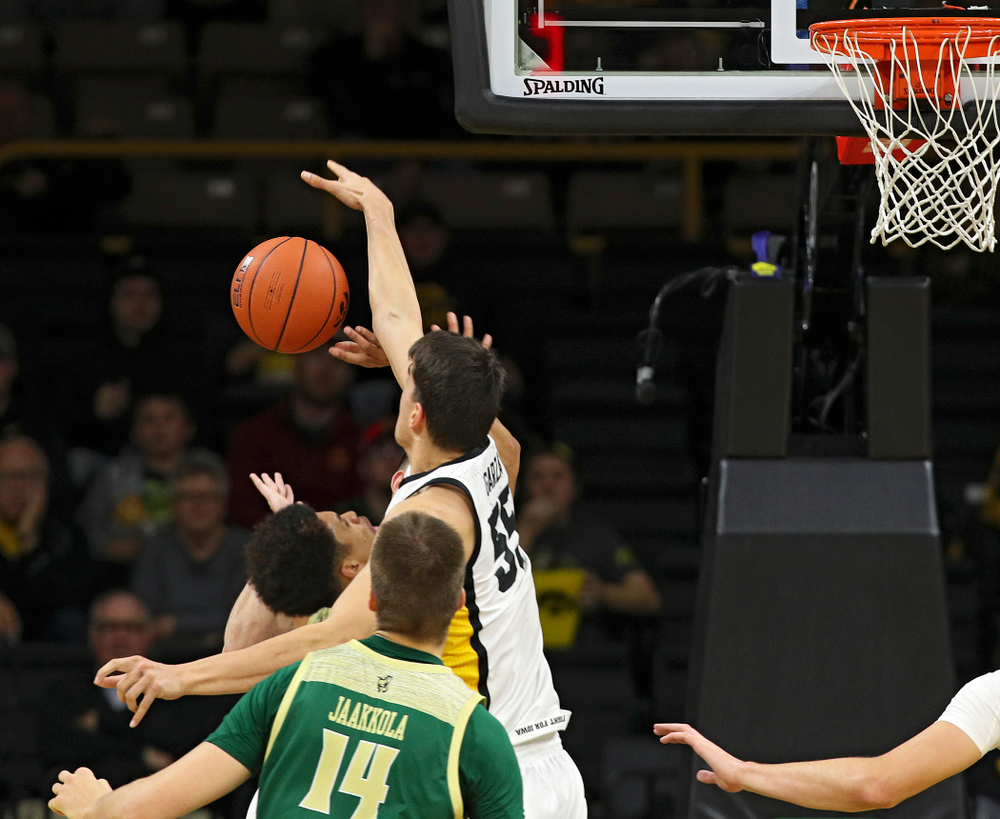 Iowa Hawkeyes center Luka Garza (55) blocks a shot during the first half of their game at Carver-Hawkeye Arena in Iowa City on Sunday, Nov 24, 2019. (Stephen Mally/hawkeyesports.com)