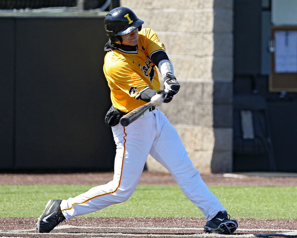 Iowa Hawkeyes catcher Austin Martin (34) hits a 2-run triple during the third inning against Illinois at Duane Banks Field in Iowa City on Sunday, Mar. 31, 2019. (Stephen Mally/hawkeyesports.com)