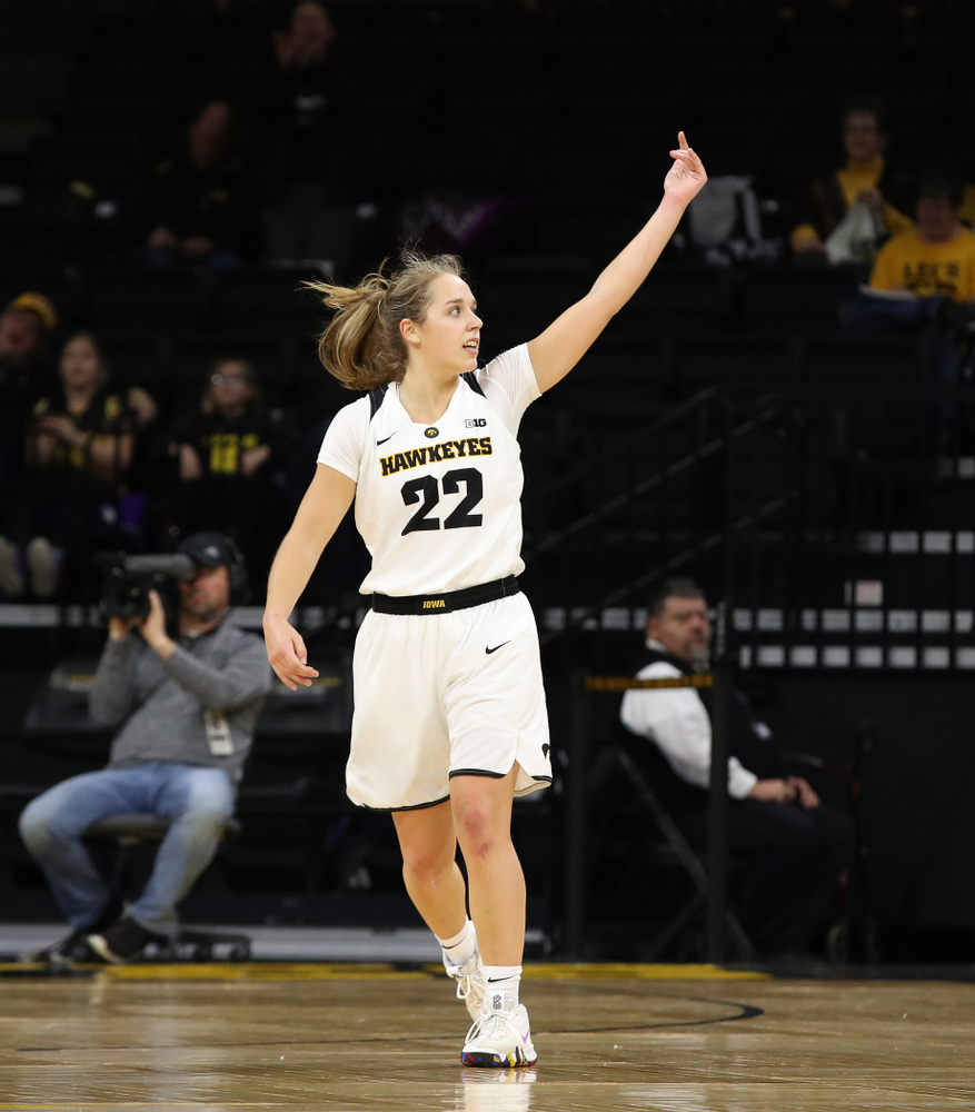 Iowa Hawkeyes guard Kathleen Doyle (22) pumps up the crowd against the Wisconsin Badgers Monday, January 7, 2019 at Carver-Hawkeye Arena.  (Brian Ray/hawkeyesports.com)