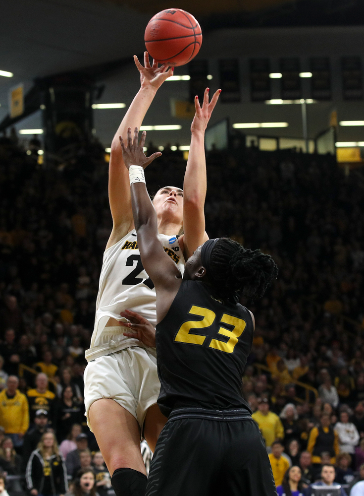 Iowa Hawkeyes forward Hannah Stewart (21) scores a basket during the third quarter of their second round game in the 2019 NCAA Women's Basketball Tournament at Carver Hawkeye Arena in Iowa City on Sunday, Mar. 24, 2019. (Stephen Mally for hawkeyesports.com)