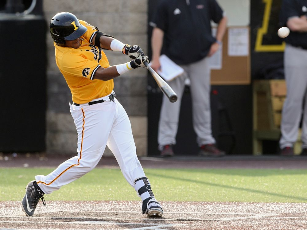 Iowa Hawkeyes first baseman Izaya Fullard (20) drives in a run with a sacrifice fly during the fourth inning of their game against Northern Illinois at Duane Banks Field in Iowa City on Tuesday, Apr. 16, 2019. (Stephen Mally/hawkeyesports.com)