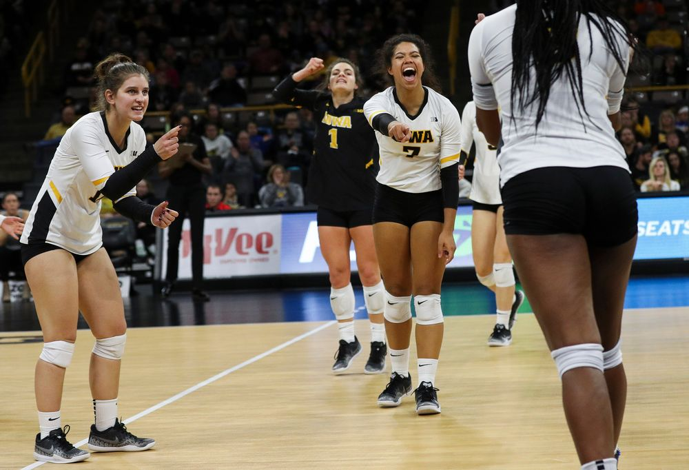Iowa Hawkeyes defensive specialist Emily Bushman (12) and Iowa Hawkeyes setter Brie Orr (7) celebrate after winning a point during a match against Maryland at Carver-Hawkeye Arena on November 23, 2018. (Tork Mason/hawkeyesports.com)