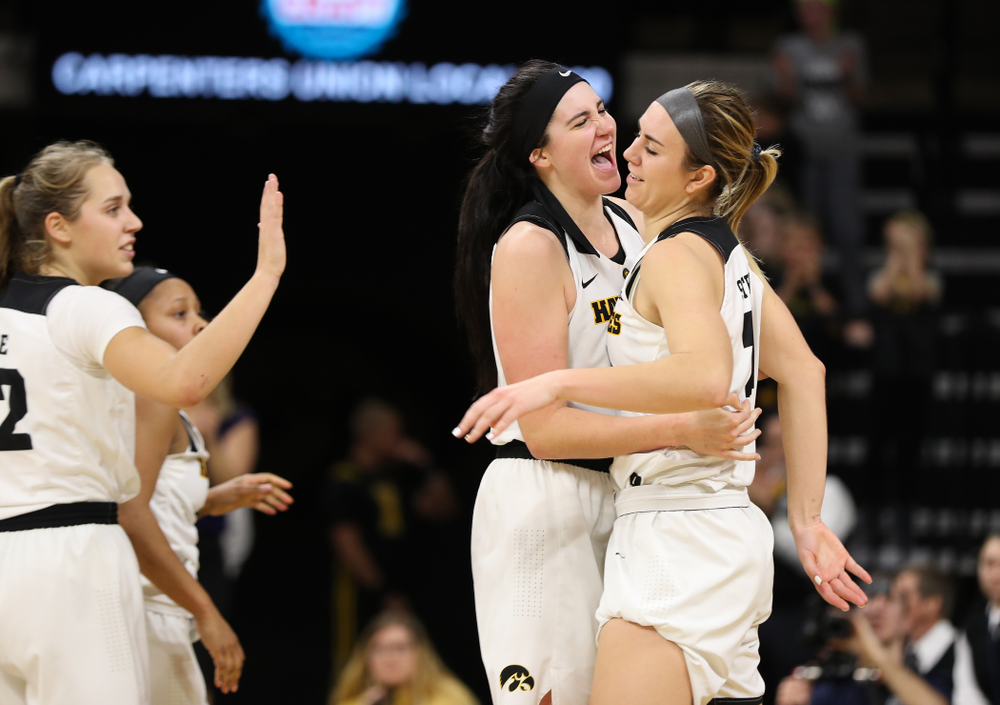 Iowa Hawkeyes forward Megan Gustafson (10) hugs i21#2 after she picked up an offensive rebound late against the Nebraska Cornhuskers Thursday, January 3, 2019 at Carver-Hawkeye Arena. (Brian Ray/hawkeyesports.com)