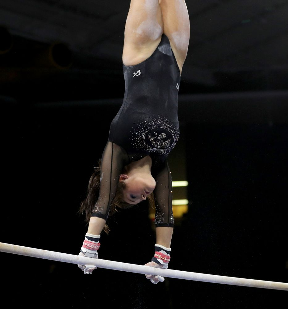 Iowa's Erin Castle competes on the bars against Michigan Friday, February 14, 2020 at Carver-Hawkeye Arena. (Brian Ray/hawkeyesports.com)