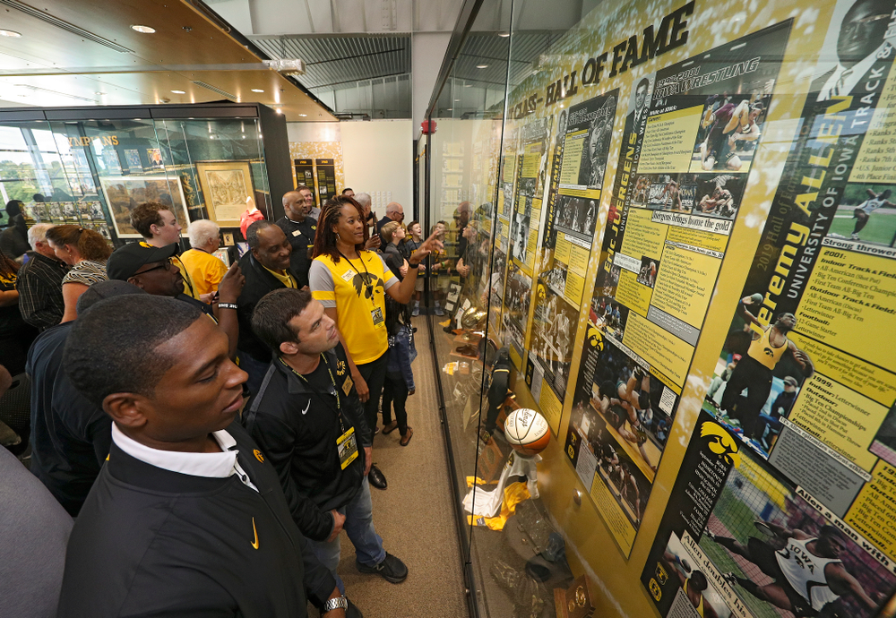 2019 University of Iowa Athletics Hall of Fame inductee Jeremy Allen, Eric Juergens, and Tangela Smith look at their exhibit after it was unveiled at the University of Iowa Athletics Hall of Fame in Iowa City on Friday, Aug 30, 2019. (Stephen Mally/hawkeyesports.com)