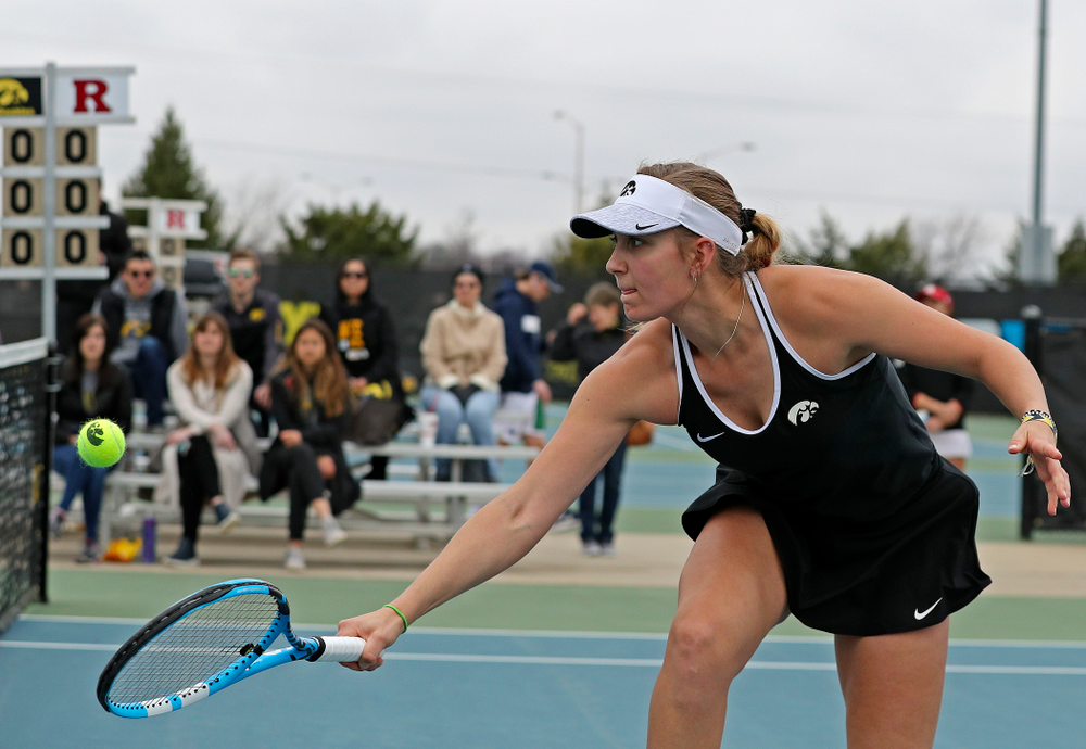 Iowa's Ashleigh Jacobs returns a shot during their doubles match against Rutgers at the Hawkeye Tennis and Recreation Complex in Iowa City on Friday, Apr. 5, 2019. (Stephen Mally/hawkeyesports.com)