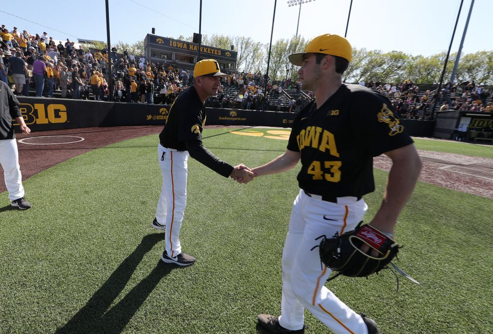 Iowa Hawkeyes head coach Rick Heller shakes hands with closer Grant Leonard (43) following game two against UC Irvine Saturday, May 4, 2019 at Duane Banks Field. (Brian Ray/hawkeyesports.com)