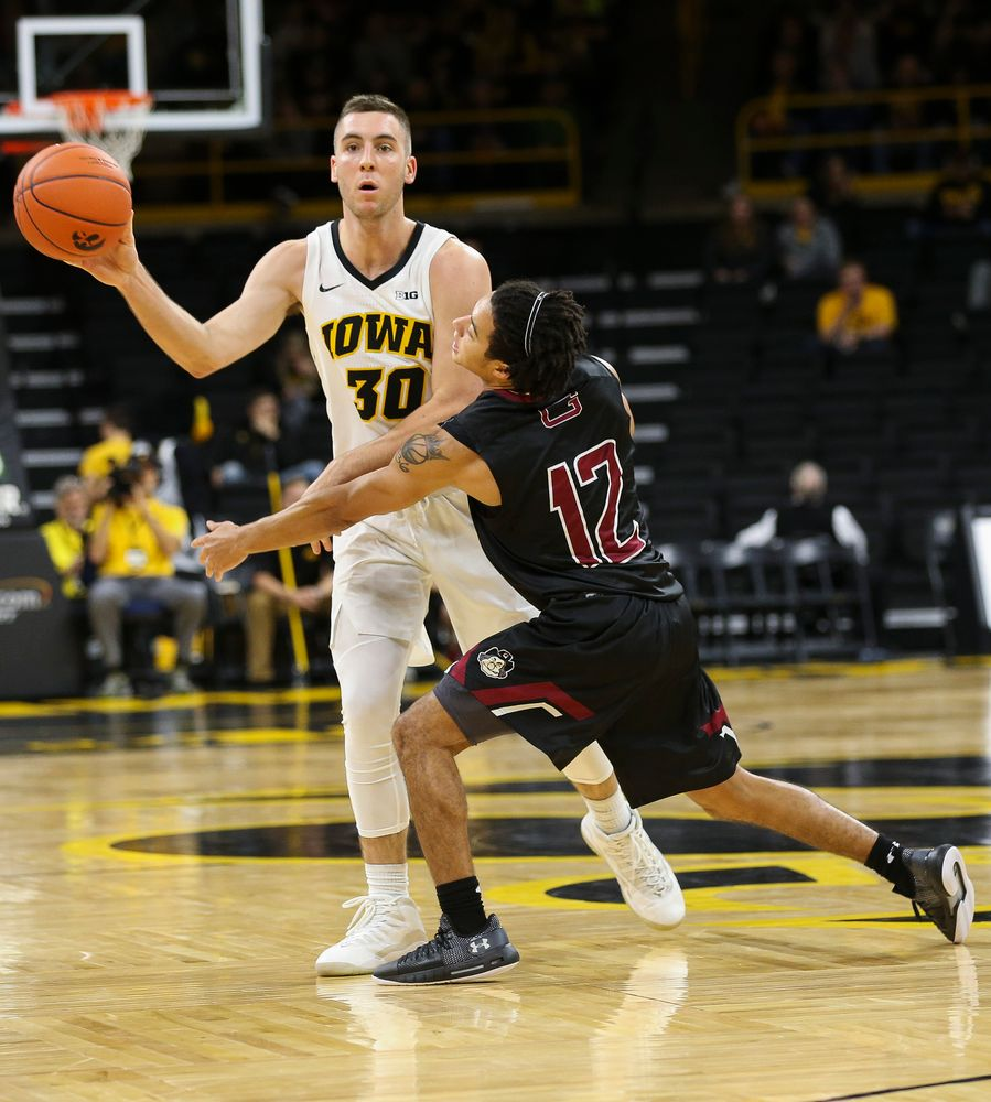 Iowa Hawkeyes guard Connor McCaffery (30) passes the ball during a game against Guilford College at Carver-Hawkeye Arena on November 4, 2018. (Tork Mason/hawkeyesports.com)