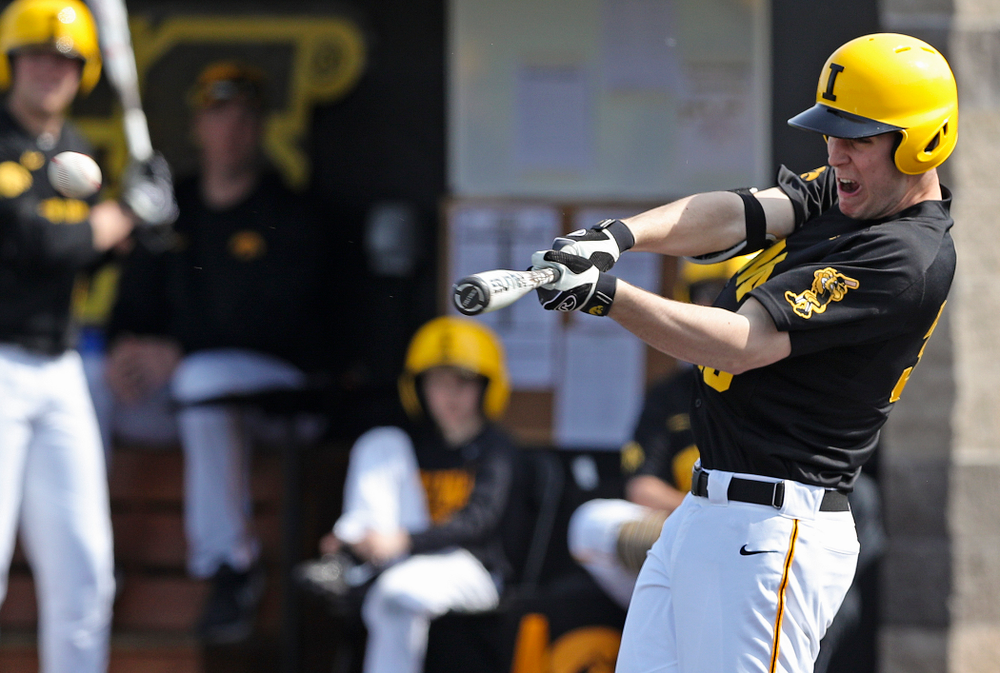 Iowa Hawkeyes right fielder Connor McCaffery (30) hits a double during the fourth inning of their game against Rutgers at Duane Banks Field in Iowa City on Saturday, Apr. 6, 2019. (Stephen Mally/hawkeyesports.com)