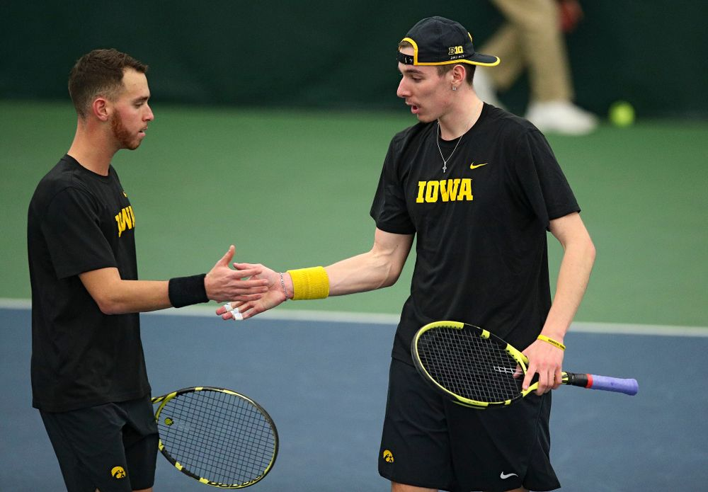 Iowa's Kareem Allaf (from left) and Nikita Snezhko celebrate after winning their doubles match at the Hawkeye Tennis and Recreation Complex in Iowa City on Friday, March 6, 2020. (Stephen Mally/hawkeyesports.com)