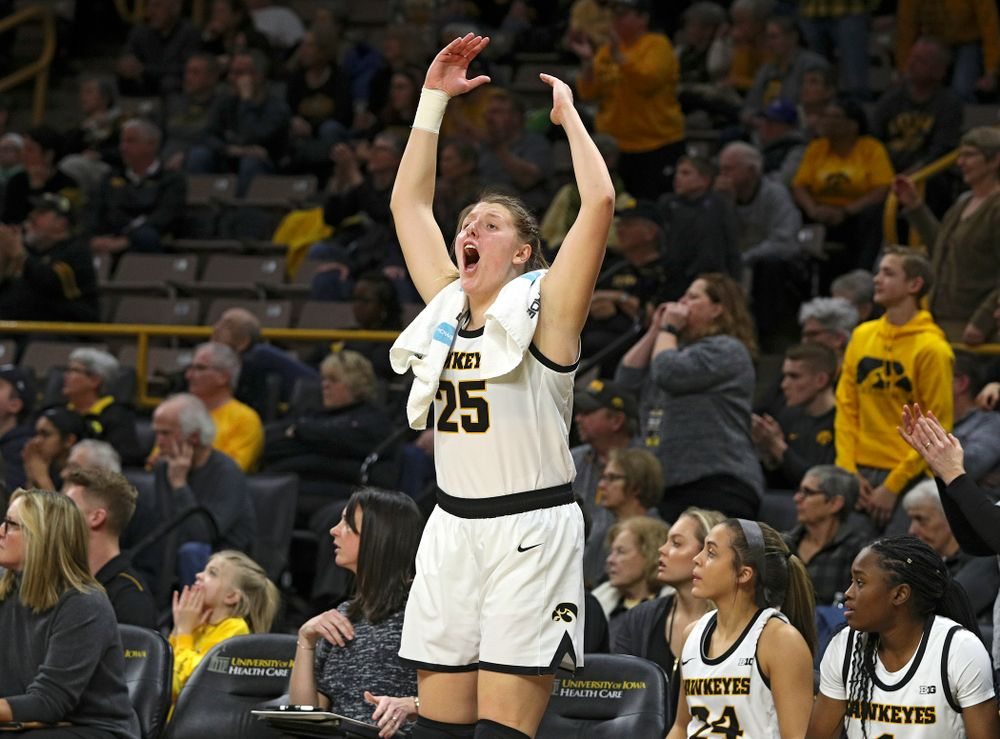 Iowa Hawkeyes forward Monika Czinano (25) pumps up the crowd during the second overtime period of their game at Carver-Hawkeye Arena in Iowa City on Sunday, January 12, 2020. (Stephen Mally/hawkeyesports.com)