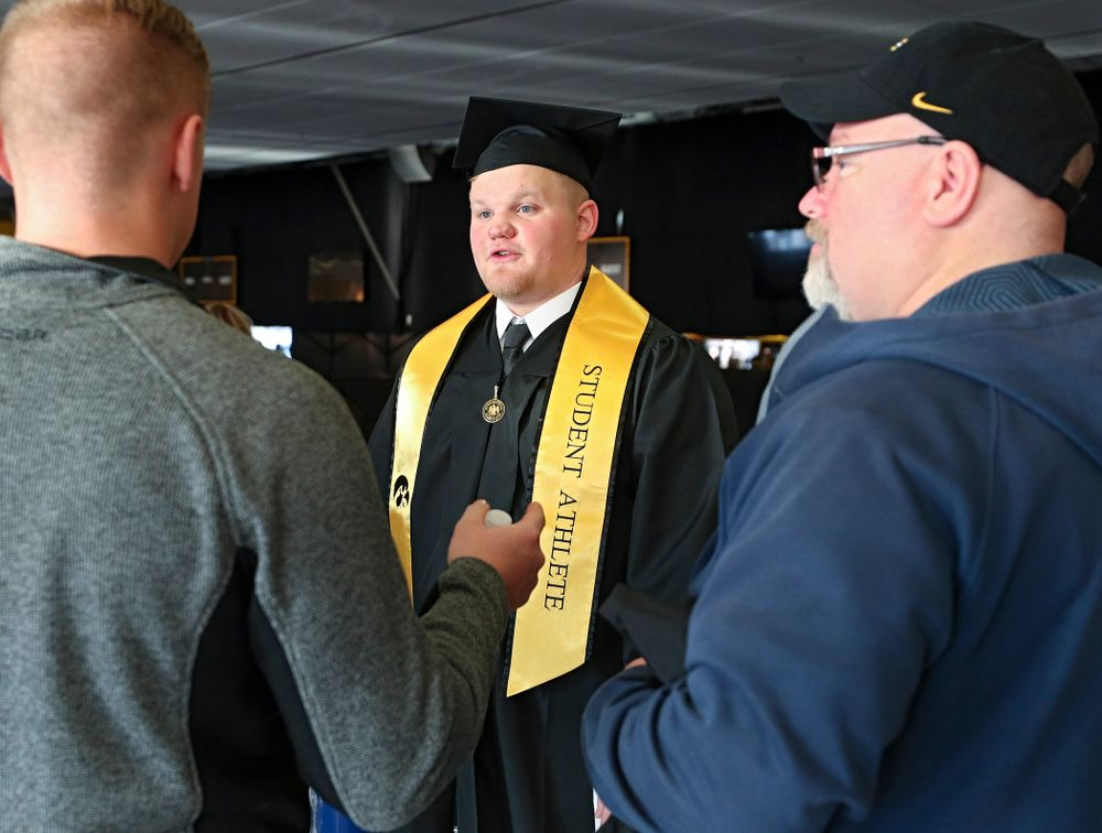 Iowa offensive lineman Spencer Williams talks on the concourse before the College of Liberal Arts and Sciences and University College Fall 2019 Commencement ceremony at Carver-Hawkeye Arena in Iowa City on Saturday, December 21, 2019. (Stephen Mally/hawkeyesports.com)