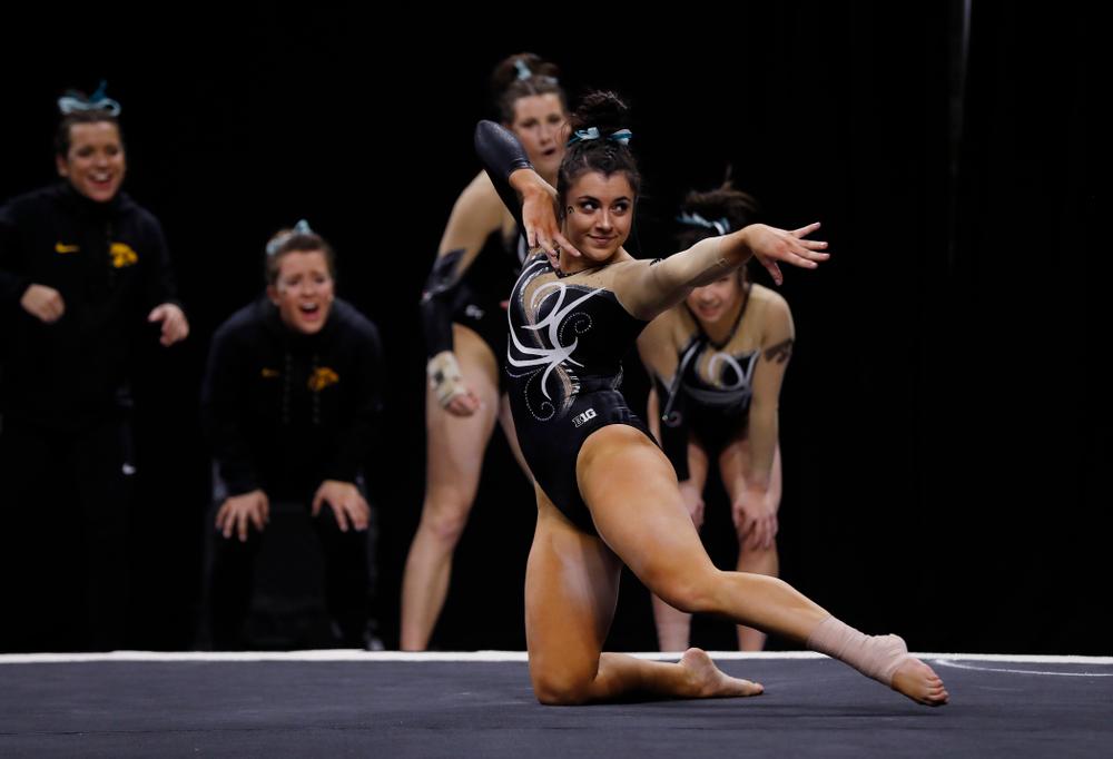 Iowa's Nikki Youd competes on the floor against the Nebraska Cornhuskers