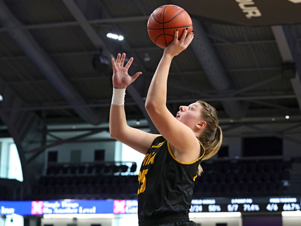 Iowa Hawkeyes forward Monika Czinano (25) makes a basket during the third quarter of their game at Welsh-Ryan Arena in Evanston, Ill. on Sunday, January 5, 2020. (Stephen Mally/hawkeyesports.com)