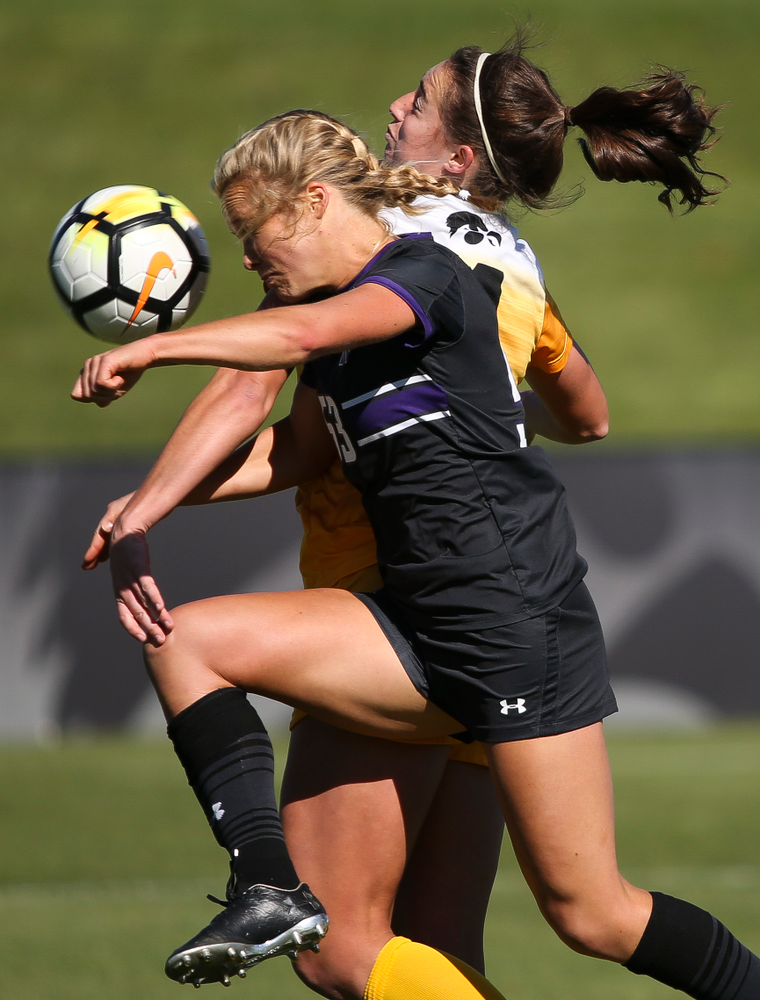 Iowa Hawkeyes forward Kaleigh Haus (4) heads the ball during a game against Northwestern at the Iowa Soccer Complex on October 21, 2018. (Tork Mason/hawkeyesports.com)