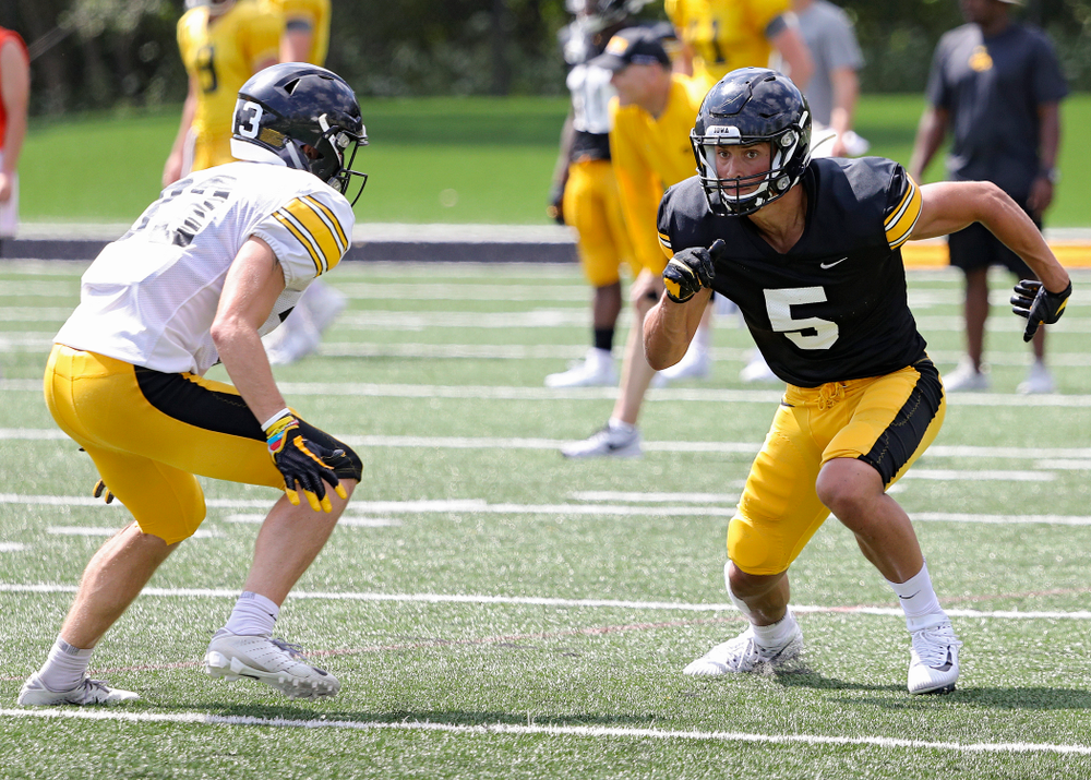 Iowa Hawkeyes wide receiver Oliver Martin (5) looks down field as linebacker Joe Evans (13) defends during Fall Camp Practice #5 at the Hansen Football Performance Center in Iowa City on Tuesday, Aug 6, 2019. (Stephen Mally/hawkeyesports.com)