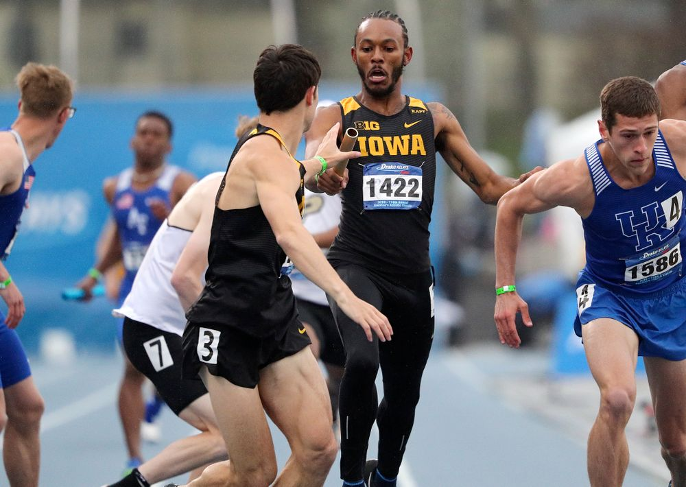 Iowa's Mar'yea Harris (right) hands off the baton to Carter Lilly as they run the men's sprint medley relay event during the third day of the Drake Relays at Drake Stadium in Des Moines on Saturday, Apr. 27, 2019. (Stephen Mally/hawkeyesports.com)