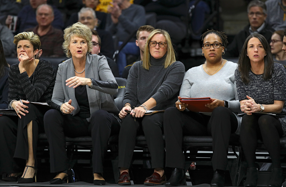Iowa associate head coach Jan Jensen (from left), head coach Lisa Bluder, special assistant to the head coach Jenni Fitzgerald, assistant coach Raina Harmon, and assistant coach Abby Stamp during the third quarter of their game at Carver-Hawkeye Arena in Iowa City on Sunday, January 12, 2020. (Stephen Mally/hawkeyesports.com)