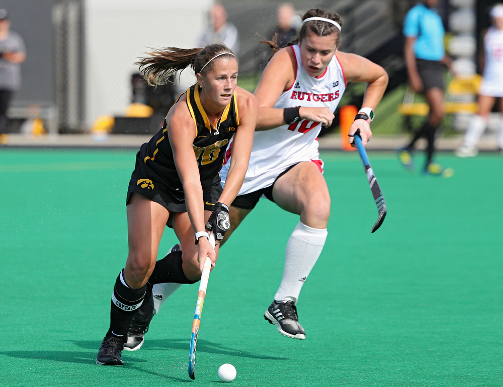 Iowa's Sophie Sunderland (20) moves with the ball during the first quarter of their match at Grant Field in Iowa City on Friday, Oct 4, 2019. (Stephen Mally/hawkeyesports.com)