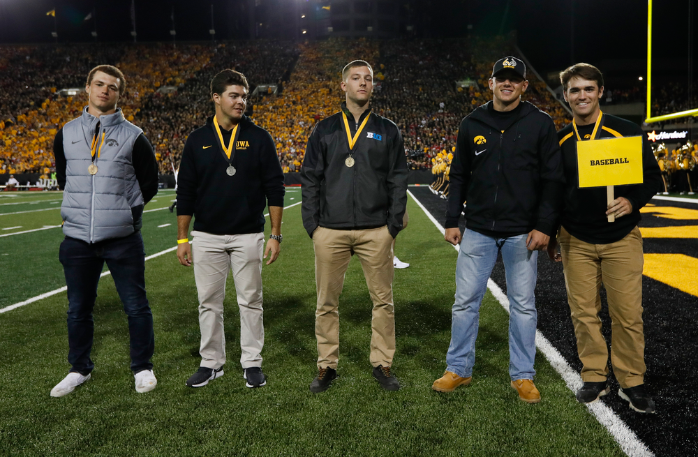 Members of the Iowa baseball team are recognized by the Presidential Committee on Athletics at halftime during a game against Wisconsin on September 22, 2018. (Tork Mason/hawkeyesports.com)