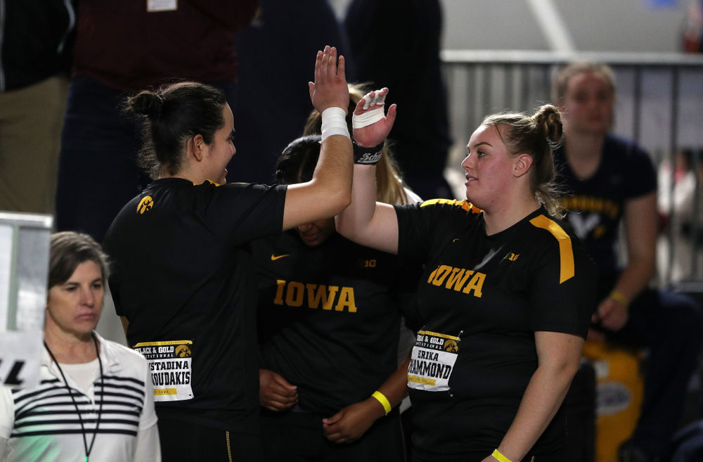 Iowa's Konstadina Spanoudakis high fives Erika Hammond as they compete in the Shot Put during the Black and Gold Premier meet Saturday, January 26, 2019 at the Recreation Building. (Brian Ray/hawkeyesports.com)