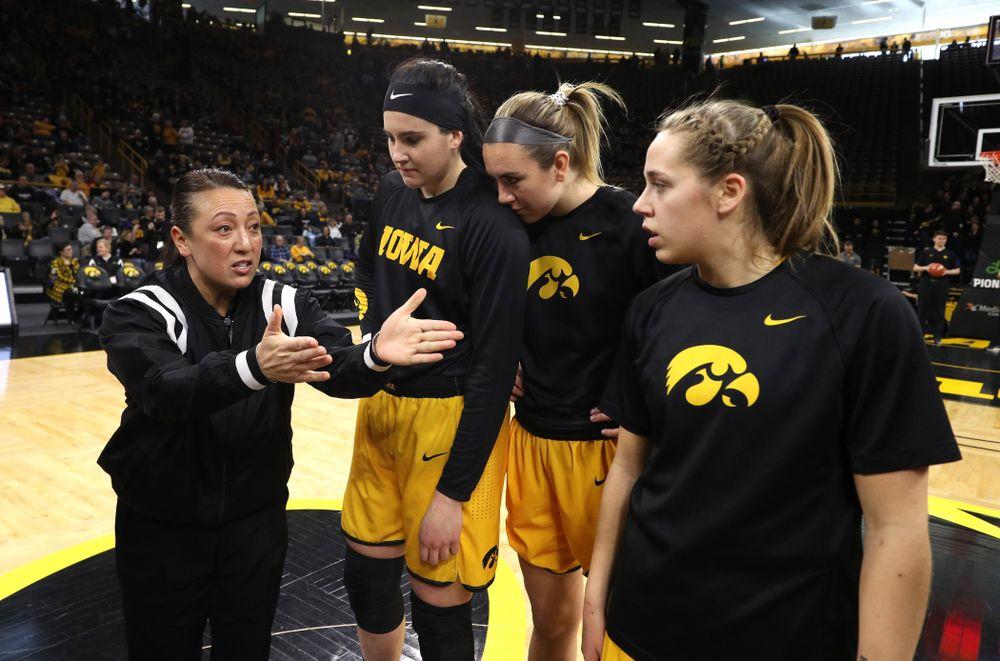 Iowa Hawkeyes forward Megan Gustafson (10), forward Hannah Stewart (21), and guard Kathleen Doyle (22) against the Northwestern Wildcats Sunday, March 3, 2019 at Carver-Hawkeye Arena. (Brian Ray/hawkeyesports.com)